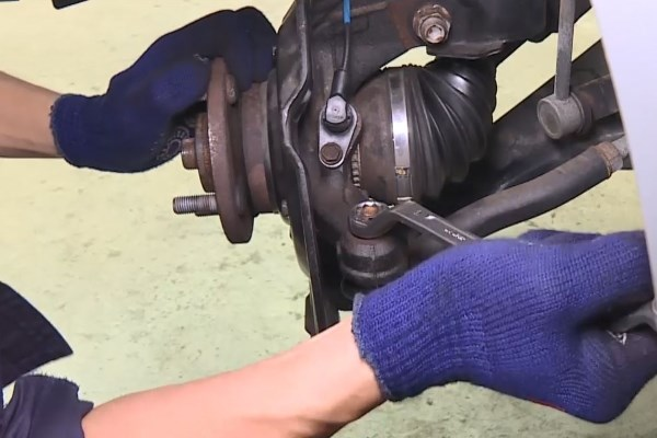 Wheel Bearing Replacement - In case the nut is rotating with the ball joint, press the ball joint further into the knuckle arm
