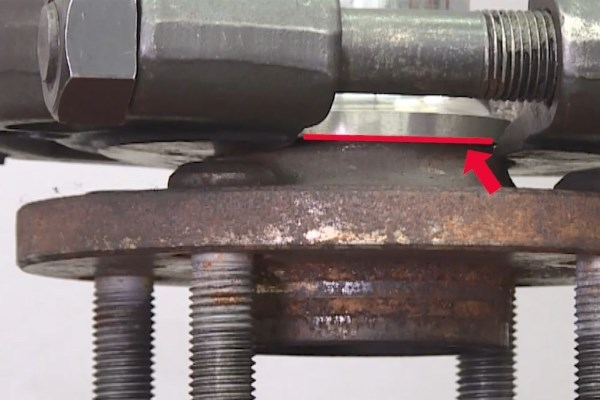 Wheel Bearing Replacement - Insert a separator into the gap between the end face of the inner ring and the wheel hub.