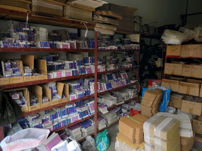 Shelves filled with fake NSK bearing boxes