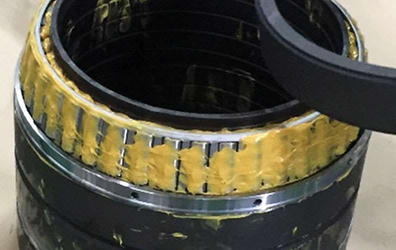 NSK's latest sealed four-row tapered roller bearings packed with water-resistant AQGRD grease, which offers double the service life of conventional bearings